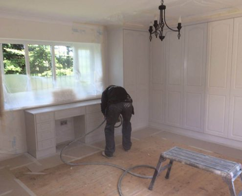 fitted wardrobes spraying Manchester
