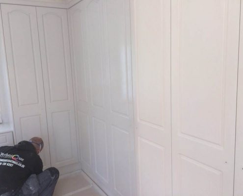 spray painting fitted wardrobes on site