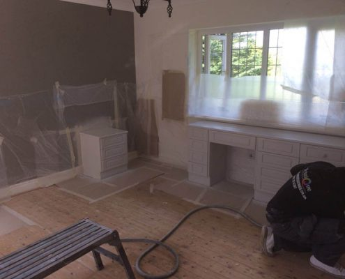 spraying the dressing table in bedroom
