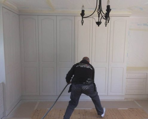 spray painting the fitted wardrobes to white
